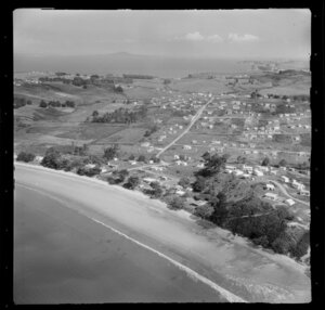 Stanmore Bay, Whangaparaoa Peninsula, Auckland Region, showing houses and beach