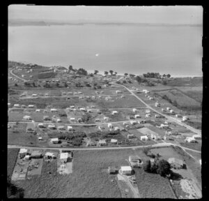Stanmore Bay, Whangaparaoa Peninsula, Auckland Region, showing houses and looking out to sea