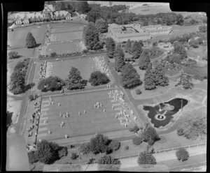 Government Gardens, Rotorua, showing players on lawn bowling greens, Blue Baths and The Bath House (later known as Rotorua Museum)