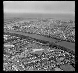 View over Wanganui Girls College, Wanganui East, with Jones Street and Middle Bridge, Anzac Parade and Dublin Street, to the Wanganui River Mouth and coast beyond