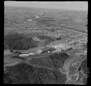 Wanganui, view of the Kempthorne Prosser Chemical Works between Brunswick Road and railway line, to Aramoho residential area and the Wanganui River with farmland beyond