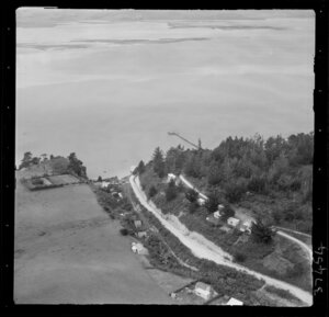 Shelly Beach, Kaipara Harbour, Auckland, coastal view to the harbour with Shelly Beach Road and wharf