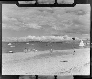 People enjoying a day at Maraetai beach, Auckland