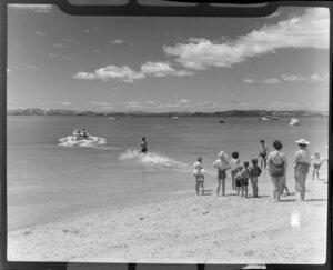 People watching a water skier at Maraetai beach, Auckland