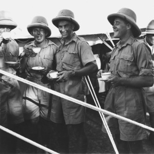 World War II soldiers with cups of tea
