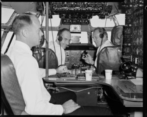 Pan American World Airways, crew in cockpit of Boeing 377 stratocruiser, Clipper Rainbow, flight to Christchurch, Whenuapai, Auckland