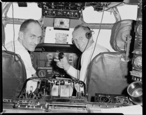 Pan American World Airways, crew in cockpit of Boeing 377 stratocruiser, Clipper Rainbow, flight to Christchurch from Whenuapai, Auckland