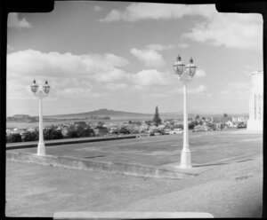 Lamps outside the Auckland War Memorial Museum, including Rangitoto Island in the distance