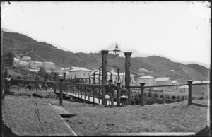 Hobson Street, Thorndon, Wellington, featuring swing bridge with unidentified persons, including road gang at far end, and houses on Tinakori Road