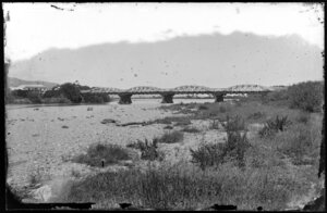 River, showing a steel bridge with multiple arches, and houses on far side of riverbank, probably Hutt Valley