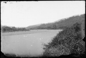 River bend, showing hills cleared for building, probably Hutt Valley