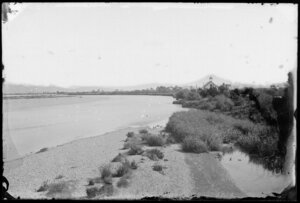 River, with a wooden building [schoolhouse? church?], on riverbank in distance, probably Hutt Valley