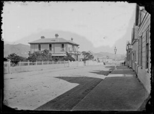 Mulgrave Street, Thorndon, Wellington, showing Bishop's Court on right, ships on Lambton Harbour in the distance