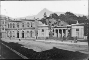 Buildings at the intersection of Featherston Street and Lambton Quay, Wellington, including The Supreme Court, and tower [observatory?] on hill behind