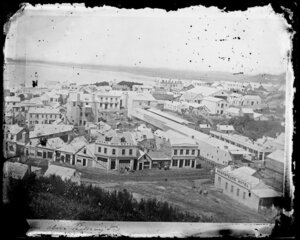 Dunedin with Rattray Street in foreground, showing houses and commercial buildings including D White's Crown Hotel, 'Skakspeare' Hotel, and the Steam Packet Dining Rooms - Photograph taken by W Meluish