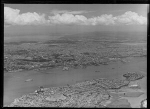 Auckland city from North Shore, showing harbour and wharves in foreground