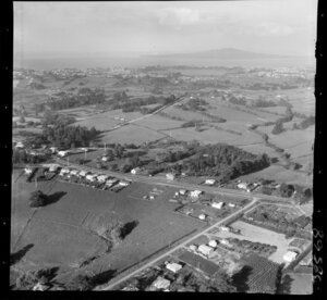 Glenfield, North Shore, Auckland, view of residential houses with roads surrounded by farmland, view to Takapuna and Lake Pupuke with Rangitoto Island beyond