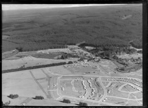 Murupara, Whakatane District, Bay of Plenty, showing newly developed housing subdivision with Pine Drive and Oregon Drive, mill workers cabins beside State Highway 38 and pine plantation beyond