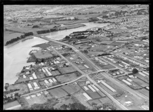 Showing Tamaki River with bridge and Southern Motorway under construction through residential area looking south with Princess Street East and Frank Grey Place, Otahuhu, Auckland