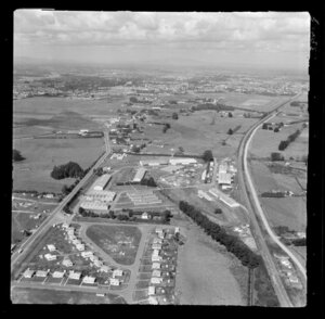 Te Rapa, Waikato, showing Air Force Camp with training grounds and housing between Te Rapa Road (State Highway 1) and railway line, looking south to the racecourse and Hamlton beyond