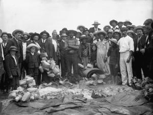 Maori group with kete, alongside hangi pits, Northland Region
