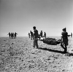 Soldiers carrying wounded on stretchers, Minqar Qaim, Egypt