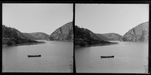 Two people in a rowing boat on a lake or inlet,[Catlins?]