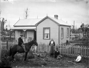 An unidentified family outside a Victorian colonial house, probably in the Stratford area