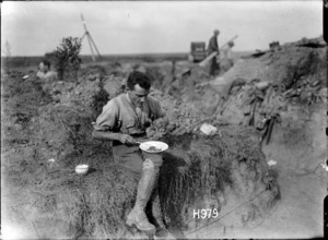 Sergeant Cyril Royston Guyton Bassett eating a meal in the trenches