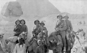 Photograph of six New Zealand soliders sitting two to a camel