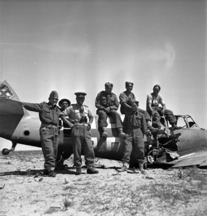 Members of the Maori Battalion in front of a German Messerschmitt fighter plane in Tripoli