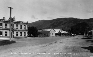 Looking along Fitzherbert Street, Featherston. In view is the garage of Arthur W Harmer and part of the Royal Hotel