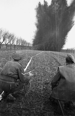 Kaye, George 1914- : NZ Engineers blow the stop banks of the Lamone River during exercises