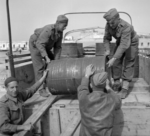 New Zealand soldiers loading a truck with supplies, Tripoli