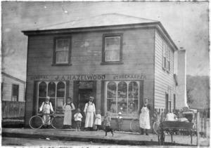 Group standing outside J A Hazelwood's general store, Main Street, Upper Hutt