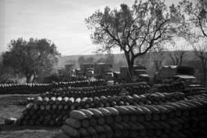 Looking over an ammunition dump at New Zealand and American military trucks, Volturno Valley, Italy