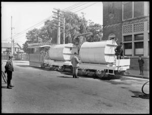 Steam tram towing boiler tanks, near a bridge, Christchurch