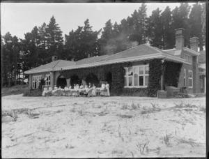 Karitane hospital, Christchurch, showing nurses standing outside with bassinets