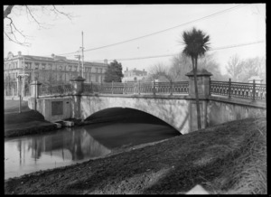 The stone bridge at Worcester Street across the Avon River, Christchurch, featuring the Clarendon Hotel in the background
