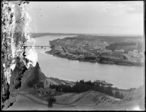 A view of Whanganui township and river, with ships docked along the shoreline