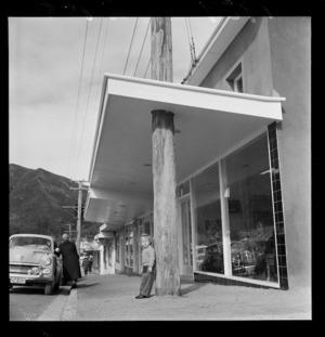 Shop verandah built around a wooden telegraph pole, Wainuiomata
