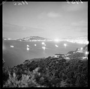 Night view of Russian whaling fleet in Wellington harbour