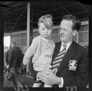 Unidentified man with young boy in his arms, Wellington Plunket Shield cricket team
