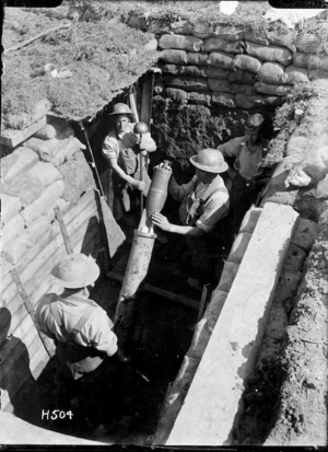 Soldiers loading a New Zealand trench mortar, near Colincamps, France
