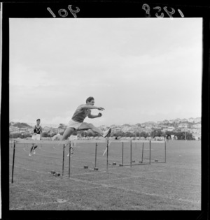Mr J H Joyce competing in the hurdles for Australian Universities at Athletic Park, Wellington