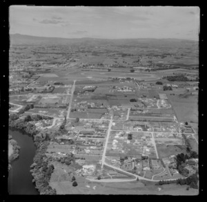 Hamilton City with Hamilton Golf Course and Braid Road with new housing development in foreground, with Te Rapa Racecourse beyond, Waikato Region