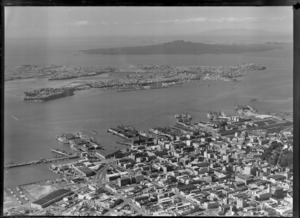 Auckland city centre with Albert Park and the Ports of Auckland wharves and harbour entrance, with Devonport and Rangitoto Island beyond