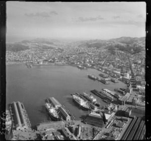 Wellington City Harbour with Customhouse and Waterloo Quay wharf areas in foreground to Te Aro Flat, Oriental Bay and Mount Victoria, looking south to Newtown beyond