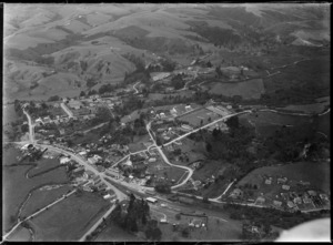 The town of Kawakawa with Railway Station and State Highway into Gillies Street with Wallace Supplies shop, surrounded by hilly farmland, Northland Region