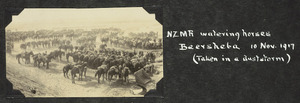 Soldiers of the New Zealand mounted Rifles watering horses in a dust storm
